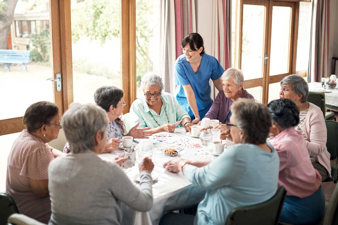 nurse-and-residents-around-table